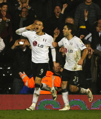 LONDON - FEBRUARY 24: Bobby Zamora of Fulham celebrates his goal with Clint Dempsey of Fulham during the FA Cup sponsored by E.on Fifth Round Replay match between Fulham and Swansea City at Craven Cottage on February 24, 2009 in London, England.  (Photo b