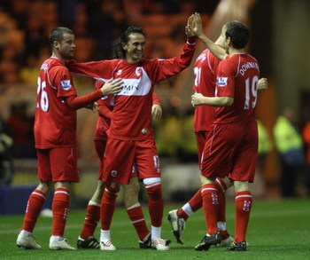 MIDDLESBROUGH, UNITED KINGDOM - FEBRUARY 25:  Tuncay Sanli of Middlesbrough is congratulated after the second goal during the FA Cup 5th Round Replay match sponsored by e.on between Middlesbrough and West Ham United at The Riverside Stadium on February 25