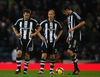 BLACKBURN, UNITED KINGDOM - JANUARY 17:l-r Michael Owen, Nicky Butt and Andrew Carroll of Newcastle show their dissapointment  during the Barclays Premier League match between Blackburn Rovers and Newcastle United at Ewood Park on January 17, 2009 in Blac