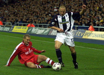 9 Oct 2001:  Larus Sigurdsson of West Brom is challenged by Jonaton Johansson of Charlton during the Worthington Cup, Third Round game between West Bromwich Albion and Charlton Athletic at The Hawthorns, West Bromwich.  DIGITAL IMAGE.  Mandatory Credit:Mi