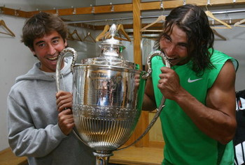 LONDON - JUNE 15:  Rafael Nadal (R) of Spain and Marc Lopez of Spain pose with the trophy after Nadal's victory during the Men's Singles Final match against Novak Djokovic of Serbia on Day 7 of the Artois Championships at Queen's Club on June 15, 2008 in