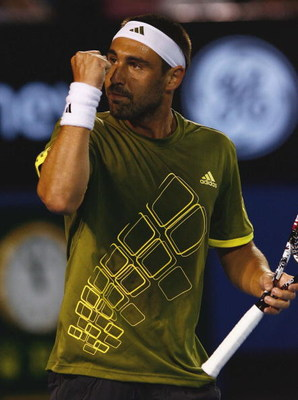 MELBOURNE, AUSTRALIA - JANUARY 25:  Marcos Baghdatis of Cyprus celebrates after winning a point in his fourth round match against Novak Djokovic of Serbia during day seven of the 2009 Australian Open at Melbourne Park on January 25, 2009 in Melbourne, Aus