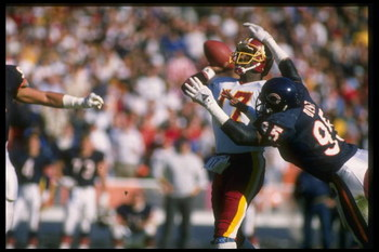 13 Nov 1988: Richard Dent #95 of the Chicago Bears goes after Washington Redskins quarterback Doug Williams during the Bears 34-14 victory over the Redskins at RFK Stadium in Washington, D. C.