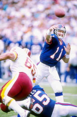 2 Oct 1988:  Quarterback Phil Simms of the New York Giants passes the ball during a game against the Washington Redskins at RFK Stadium in Washington, D.C.  The Giants won the game 24-23. Mandatory Credit: Allen Steele  /Allsport