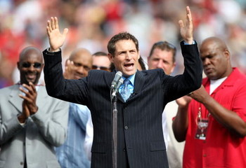 SAN FRANCISCO - OCTOBER 05: Former San Francisco 49ers quarterback Steve Young speaks during a ceremony to retire his number at halftime of the New England Patriots and the San Francisco 49ers NFL game on October 5, 2008 at Candlestick Park in San Francis