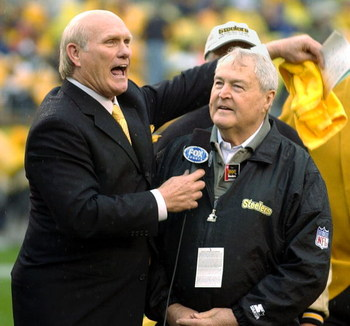 PITTSBURGH - OCTOBER 26:  Former quarterback Terry Bradshaw (L) and head coach Chuck Noll (R) of the Pittsburgh Steelers appear during a pre-game ceremony to celebrate the Steelers' 1000th game before the game against the St. Louis Rams on October 26, 200