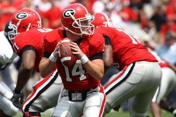 ATHENS, GA - AUGUST 30:  Quarterback Joe Cox #14 of the Georgia Bulldogs takes a snap and looks to hand the ball off during the game against the Georgia Southern Eagles at Sanford Stadium on August 30, 2008 in Athens, Georgia.  The Bulldogs defeated the E