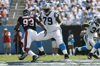 CHARLOTTE, NC - SEPTEMBER 14:  Jeff Otah #79 of the Carolina Panthers blocks against Adewale Ogunleye #93 of the Chicago Bears during the game at Bank of America Stadium on September 14, 2008 in Charlotte, North Carolina. (Photo by Kevin C. Cox/Getty Imag