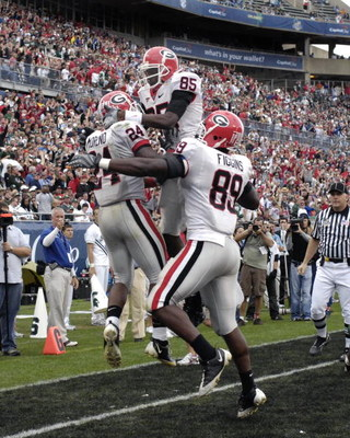 ORLANDO, FL - JANUARY 1: Running back Knowshon Moreno #24 of the University of Georgia celebrates a touchdown catch with Demiko Goodman #85 and Bruce Figgins #89 against the Michigan State Spartans during the 2009 Capital One Bowl at the Citrus Bowl on Ja