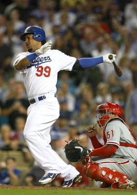 LOS ANGELES, CA - OCTOBER 15:  Manny Ramirez #99 of the Los Angeles Dodgers swings at a pitch in the eighth inning against the Philadelphia Phillies in Game Five of the National League Championship Series during the 2008 MLB playoffs on October 15, 2008 a