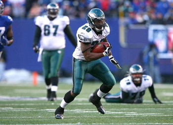 EAST RUTHERFORD, NJ - JANUARY 11:  Correll Buckhalter #28 of the Philadelphia Eagles runs with the ball during the NFC Divisional Playoff Game against the New York Giants on January 11, 2009 at Giants Stadium in East Rutherford, New Jersey.  The Eagles de