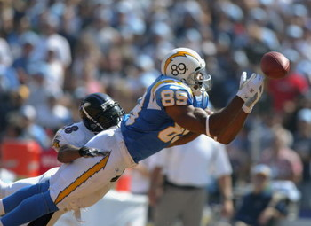 SAN DIEGO - SEPTEMBER 21:  The ball slips through the hands of wide receiver David Boston #89 of the San Diego Chargers as Gary Baxter #28 of the Baltimore Ravens defends on September 21, 2003 at Qualcomm Stadium in San Diego, California. The Ravens defea