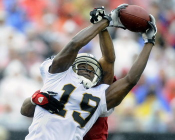 TAMPA, FL - NOVEMBER 30:  Wide receiver Devery Henderson #19 of the New Orleans Saints grabs a pass against the Tampa Bay Buccaneers at Raymond James Stadium on November 30, 2008 in Tampa, Florida.  (Photo by Al Messerschmidt/Getty Images)