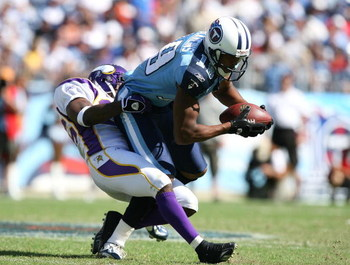 NASHVILLE, TN - SEPTEMBER 28:  Antone Winfield #26 of the Minnesota Vikings brings down wide receiver Justin McCareins #19 of the Tennessee Titans at LP Field on September 28, 2008 in Nashville, Tennessee. The Titans defeated the Vikings 30-17.  (Photo by