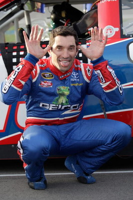 LAS VEGAS - FEBRUARY 27: Max Papis driver of the #13 Geico Toyota goofs off during qualifying for the NASCAR Sprint Cup Series Shelby 427 at the Las Vegas Motor Speedway on February 27, 2009 in Las Vegas, Nevada.  (Photo by John Harrelson/Getty Images for