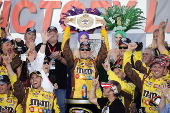 LAS VEGAS - MARCH 01:  Kyle Busch, driver of the #18 M&M's Toyota, celebrates in Victory Lane after winning the NASCAR Sprint Cup Series Shelby 427 at the Las Vegas Motor Speedway on March 1, 2009 in Las Vegas, Nevada.  (Photo by Rusty Jarrett/Getty Image