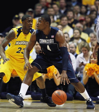 MILWAUKEE - FEBRUARY 25: Jeff Adrien #4 of the Connecticut Huskies moves against Wesley Matthews #23 of the Marquette Golden Eagles on February 25, 2009 at the Bradley Center in Milwaukee, Wisconsin. Connecticut defeated Marquette 93-82. (Photo by Jonatha