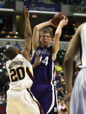 INDIANAPOLIS - MARCH 13:  Kevin Coble #44 of the Northwestern Wildcats looks to pass against Lawrence Westbrook #20 of the Minnesota Golden Gophers during the Big Ten Men's Basketball Tournament at Conseco Fieldhouse on March 13, 2008 in Indianapolis, Ind