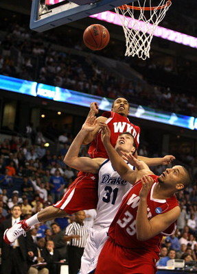 TAMPA, FL - MARCH 21:  Jonathan Cox #31 of the Drake Bulldogs fights for a rebound with D.J. Magley #35 and Courtney Lee #32 of the Western Kentucky Hilltoppers during the first round of the 2008 NCAA Tournament West Regional at the St. Pete Times Forum o