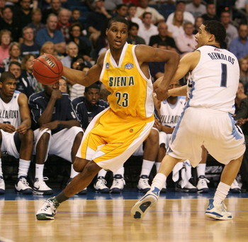 TAMPA, FL - MARCH 23:  Edwin Ubiles #23 of the Siena Saints brings the ball toward the basket agianst Scottie Reynolds #1 of the Villanova Wildcats in the second round of the 2008 NCAA Tournament Midwest Regional at the St. Pete Times Forum on March 23, 2