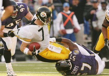 BALTIMORE - NOVEMBER 26:  Ben Roethlisberger #7 of the Pittsburgh Steelers is sacked by Jarret Johnson #95 and Bart Scott #57 of the Baltimore Ravens at M & T Bank Stadium November 26, 2006 in Baltimore, Maryland.  (Photo by Nick Laham/Getty Images)