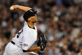 NEW YORK - SEPTEMBER 21:  Starting pitcher Andy Pettitte #46 of the New York Yankees deals against the Baltimore Orioles during the last regular season game at Yankee Stadium on September 21, 2008 in the Bronx borough of New York City. The Yankees are pla