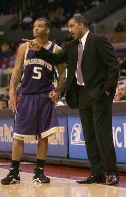 LOS ANGELES - MARCH 12:  Head coach Lorenzo Romar talks with Will Conroy #5 of the Washington Huskies during the 2005 Pacific Life Pac-10 Men's Basketball Tournament final game against the Arizona Wildcats at Staples Center on March 12, 2005 in Los Angele