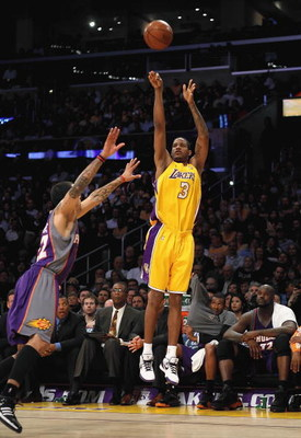 LOS ANGELES, CA - FEBRUARY 26:  Trevor Ariza #3 of the Los Angeles Lakers shoots a three point shot over Matt Barnes #22 of the Phoenix Suns during the NBA game at Staples Center on February 26, 2009 in Los Angeles, California.   The Lakers defeated the S