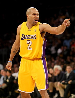 LOS ANGELES - JANUARY 27: Derek Fisher #2 of the Los Angeles Lakers points in the game with the Charlotte Bobcats on January 27, 2009 at Staples Center in Los Angeles, California.  The Bobcats won 117-110 in double overtime.  NOTE TO USER: User expressly