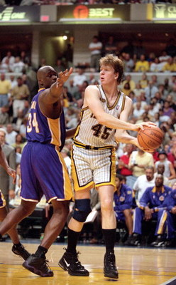 16 Jun 2000:  Rik Smits #45 of the Indiana Pacers steals the ball from Shaquille O''Neal #34 of the Los Angeles Lakers during the NBA Finals Game 4 at the Conseco Fieldhouse in Indianapolis, Indiana.  The Lakers defeated the Pacers in overtime 120-118. Th