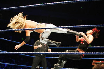 SYDNEY, AUSTRALIA - JUNE 15: Michelle McCool delivers a dropkick to Victoria during WWE Smackdown at Acer Arena on June 15, 2008 in Sydney, Australia.  (Photo by Gaye Gerard/Getty Images)