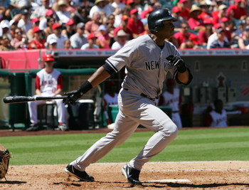 ANAHEIM, CA - AUGUST 27: Bernie Williams #51 of the New York Yankees swings at the putch during the game against the Los Angeles Angels of Anaheim at Angel Stadium in Anaheim, California.  The Yankees won 11-8.  (Photo by Lisa Blumenfeld/Getty Images)