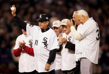 CHICAGO - OCTOBER 22:  Baseball Hall of Famer and former Chicago White Sox player Luis Aparicio waves from the mound with other former White Sox players before the ceremonial first pitch before the Chicago White Sox take on the Houston Astros during Game