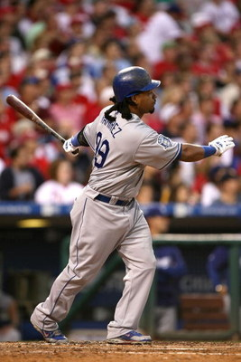 PHILADELPHIA - OCTOBER 10:  Manny Ramirez #99 of the Los Angeles Dodgers hits a 3-run home run in the top of the fourth inning against the Philadelphia Phillies in Game Two of the National League Championship Series during the 2008 MLB playoffs on October