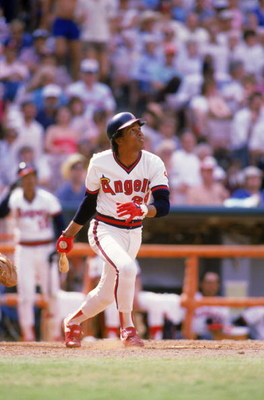 ANAHEIM, CA - 1985:  Infielder Rod Carew #29 of the California Angels watches the flight of his hit as he runs to first during a 1985 MLB game at Angel Stadium in Anaheim, California. (Photo by Rick Stewart/Getty Images)