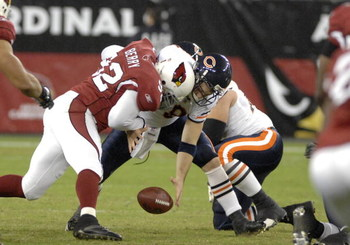 Chicago Bears quarterback Rex Grossman fumbles against the Arizona Cardinals Oct. 16, 2006 in Phoenix.  The Bears won 24 - 23 on Monday Night Football and remained undefeated.  (Photo by Al Messerschmidt/Getty Images)