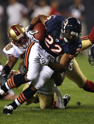 CHICAGO - AUGUST 21:  Matt Forte #22 of the Chicago Bears breaks away from Mark Roman #26 of the San Francisco 49ers on August 21, 2008 at Soldier Field in Chicago, Illinois. The 49ers defeated the Bears 37-30. (Photo by Jonathan Daniel/Getty Images)