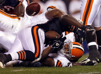 CLEVELAND - AUGUST 28:  Ervin Baldwin #99 of the Chicago Bears causes Charles Ali #41 of the Cleveland Browns to fumble the ball during a preseason NFL game at Cleveland Browns Stadium on August 28, 2008 in Cleveland, Ohio.  (Photo by Matt Sullivan/Getty