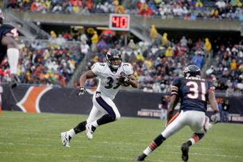 CHICAGO - OCTOBER 23:  Fullback Justin Green #33 of the Baltimore Ravens evades cornerback Nathan Vasher #31 of the Chicago Bears during their game on October 23, 2005 at Soldier Field in Chicago, Illinois. The Bears defeated the Ravens 10-6.(Photo by Jim