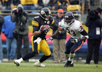 PITTSBURGH - DECEMBER 11:  Cedrick Wilson #80 of the Pittsburgh Steelers carries the ball against Charles Tillman #33 of the Chicago Bears during the NFL game on December 11, 2005 at Heinz Field in Pittsburgh, Pennsylvania. The Steelers won 21-9. (Photo b
