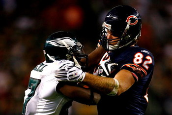 CHICAGO - SEPTEMBER 28:  Greg Olsen #82 of the Chicago Bears blocks Quintin Mikell #27 of the Philadelphia Eagles at Soldier Field on September 28, 2008 in Chicago, Illinois. The Bears won 24-20.  (Photo by Jeff Gross/Getty Images)