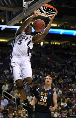 PHOENIX - MARCH 27:  Derrick Brown #5 of the Xavier Musketeers dunks the ball as Ted Talkington #32 of West Virginia Mountaineers looks on during the West Regional Sweet 16 game at the U.S. Airways Center on March 27, 2008 in Phoenix, Arizona.  (Photo by