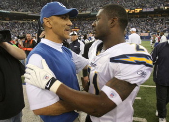 INDIANAPOLIS - JANUARY 13:  Head coach Tony Dungy of the Indianapolis Colts congratulates LaDainian Tomlinson #21 of the San Diego Chargers after the CHargers defeated the Colts 28-24 during their AFC Divisional Playoff game at the RCA Dome on January 13,