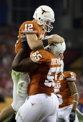 GLENDALE, AZ - JANUARY 05:  Quarterback Colt McCoy #12 of the Texas Longhorns celebrates with Cedric Dockery #55 after McCoy scored on a 14 yard touchdown rush against the Ohio State Buckeyes during the third quarter of the Tostitos Fiesta Bowl Game on Ja