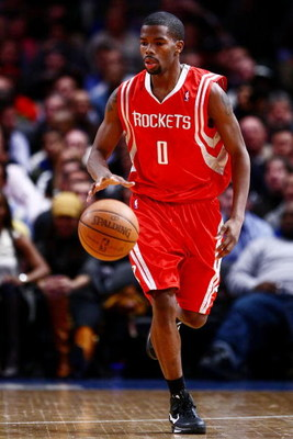 NEW YORK - JANUARY 26:  Aaron Brooks #0 of the Houston Rockets dribbles against the New York Knicks on January 26, 2009 at Madison Square Garden in New York City.  NOTE TO USER: User expressly acknowledges and agrees that, by downloading and/or using this