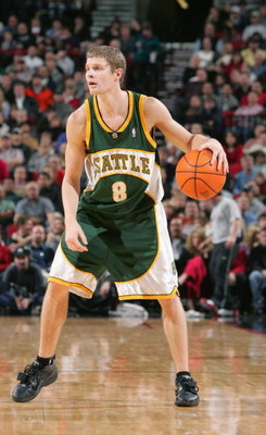 PORTLAND - NOVEMBER 30:  Luke Ridnour #8 on the Seattle Sonics moves the bal against the Portland Trail Blazers during a game on November 30, 2004 at the Rose Garden Arena in Portland, Oregon. The Blazers won 100-94. NOTE TO USER: User expressly acknowled