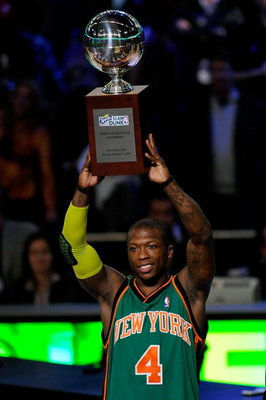PHOENIX - FEBRUARY 14:  Nate Robinson of the New York Knicks holds up the trophy after winning the Sprite Slam Dunk Contest on All-Star Saturday Night, part of 2009 NBA All-Star Weekend at US Airways Center on February 14, 2009 in Phoenix, Arizona.  NOTE