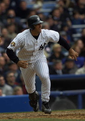 2 Apr 2001:  Jorge Posada #20 of the New York Yankees hits a home run against the Kansas City Royals on Opening Day at Yankee Stadium in Bronx, New York. The Yankees won 7-3.  Digital Image. Mandatory Credit: Jamie Squire/ALLSPORT