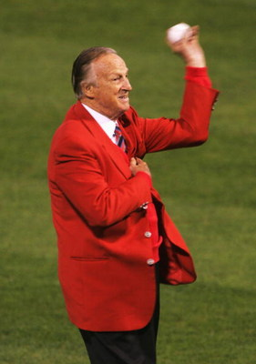 ST LOUIS - OCTOBER 26:  Hall of famer Stan 'the man' Musial throws out the first pitch before game three of the World Series between the Boston Red Sox and the St. Louis Cardinals on October 26, 2004 at Busch Stadium in St. Louis, Missouri. (Photo by Step