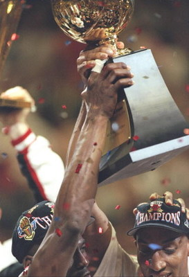 13 Jun 1997:  Scottie Pippen of the Chicago Bulls cheers as Michael Jordan (L) celebrates his MVP trophy after the Bulls win game 6 of the 1997 NBA Finals at the United Center in Chicago, Illinois. The Bulls defeated the Jazz 90-86 to win the series and c